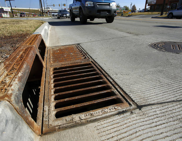 A newly installed storm drain is shown on SE 15 in Del City. The city recently completed a major road improvement project on SE 15 extending west from Sooner Road. Photo by Jim Beckel, The Oklahoman