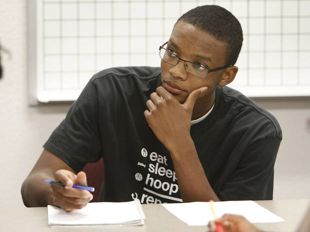 Freshman Blair Smith takes notes during math class at Oklahoma City Community College in June.  Photo By David McDaniel, The Oklahoman ARCHIVES