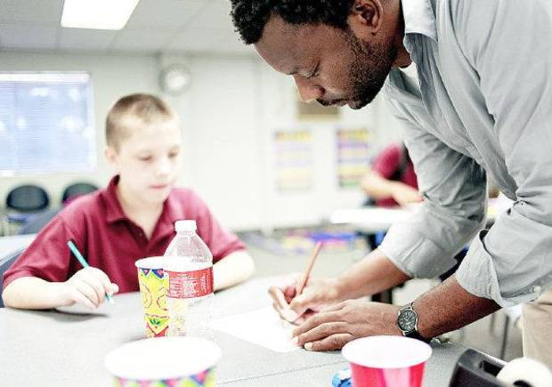 Artist Nathan Lee helps student Chuck McClellan with an art project during an after school art class at Capitol Hill Library in south Oklahoma City on Monday, September 12, 2011. Photo by John Clanton, The Oklahoman ORG XMIT: KOD