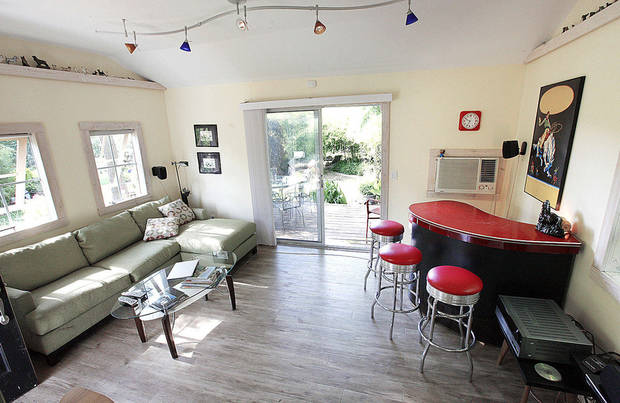 "Rob Littlefield calls his guest house ""The ""Bamboo Inn,"" a space made for lounging. <strong>PAUL B. SOUTHERLAND - The Oklahoman</strong>"
