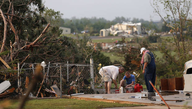 Residents begin to clean up after a tornado in Carney Okla., on Sunday, May 19, 2013. Photo by Bryan Terry, The Oklahoman