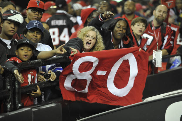 Atlanta Falcons fans celebrate after the Falcons defeated the Dallas Cowboys 19-13 in an NFL football game, Sunday, Nov. 4, 2012, in Atlanta. The Falcons remain the only undefeated team in the NFL. (AP Photo/Rich Addicks)