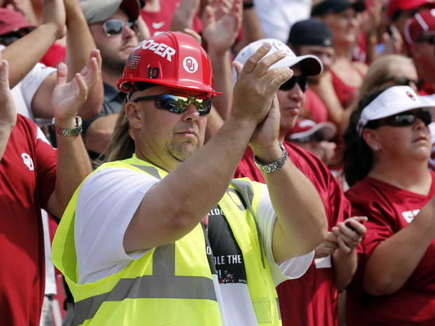 Bill Kauffman, Tulsa, wearing Bell Dozer apparel, applauds during a college football game between the University of Oklahoma Sooners (OU) and the Tulsa Golden Hurricane (TU) at Gaylord Family-Oklahoma Memorial Stadium in Norman, Okla., on Saturday, Sept. 14, 2013. Photo by Steve Sisney, The Oklahoman
