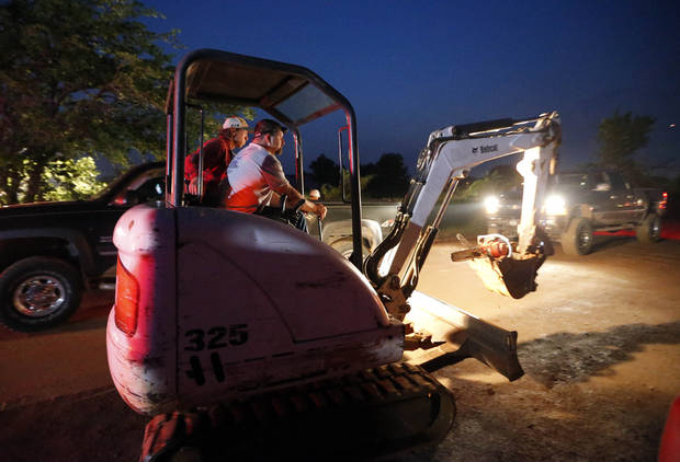 A person drives equipment to damage caused by a tornado in Bethel Acres, Okla., Sunday, May 19, 2013. Photo by Sarah Phipps, The Oklahoman