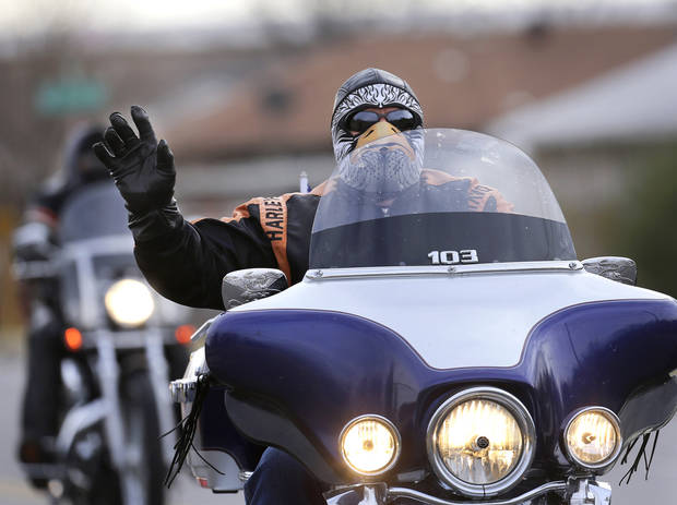 This biker is dressed for the cold temperatures ushered in overnight by a cold front. About 300 motorcycle riders participated in a charity ride in southwest Oklahoma City on Sunday afternoon, Dec. 9, 2012. Escorted by Oklahoma City police motorcycle units, the bikers traveled along SW 29 Street, S. Western, SW 44 Street and returned to Woodson Park at SW 36 and S. May Avenue.  Feed The Children and the Fellowship of Christian Bikers sponsored the motorcycle ride/toy drive.   Photo by Jim Beckel, The Oklahoman