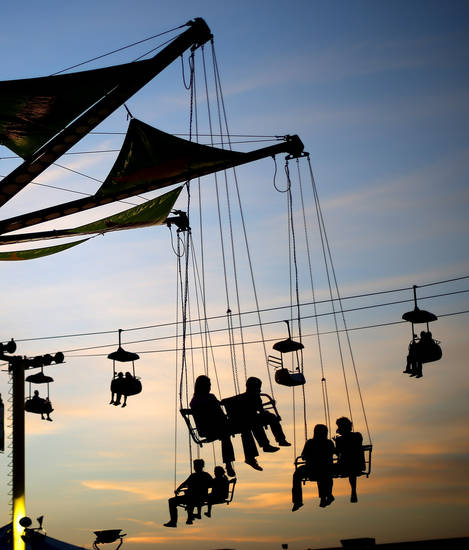 Visitors to the Oklahoma State Fair enjoy a ride after sunset in Oklahoma City, Wednesday, September 19, 2012. Photo by Bryan Terry, The Oklahoman