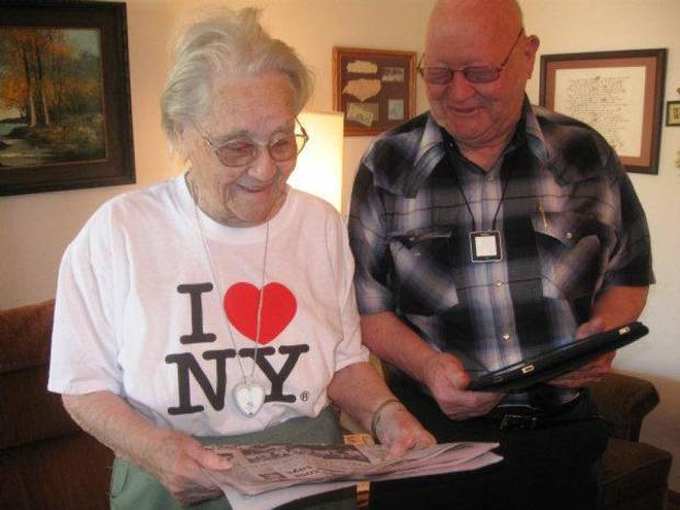 DeLois Patterson looks at her Monday edition of The Oklahoman at her Cyril home, as her son, Bill Patterson, holds an iPad displaying the same content in a digital format. <strong>DON MECOY - THE OKLAHOMAN</strong>