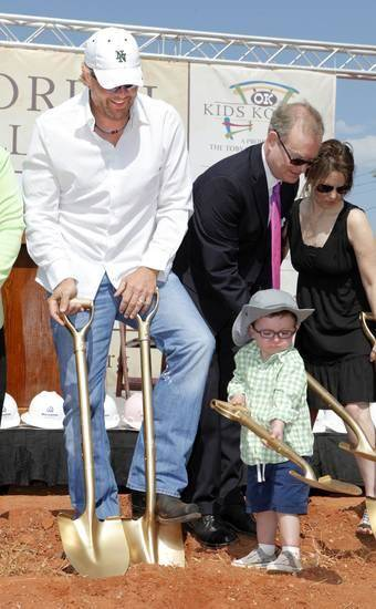 Toby Keith, left, watches as Brock Hart, then 3, from Edmond, shovels dirt during groundbreaking ceremonies for the OK Kids Korral, at NE 8 and Laird, in Oklahoma City Friday, May 18, 2012. Photo by Paul B. Southerland, The Oklahoman Archive