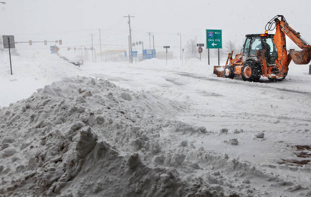Midwest City street crews clear snow from Air Depot near Interstate 40 ramps.    A winter storm created whiteout conditions and caused snow drifts that made problems for the few motorists who ventured out Tuesday morning, Feb. 1, 2011.   Photo by Jim Beckel, The Oklahoman