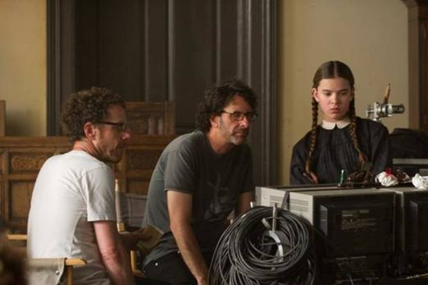 "From left, filmmakers Ethan and Joel Coen work with star Hailee Steinfeld on the set of ""True Grit."""