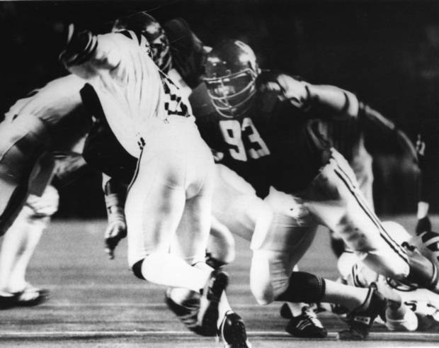 OU all-American Lee Roy Selmon bears down on Michigan quarterback Rick Leach in the 1976 Orange Bowl. (Oklahoman archive photo)