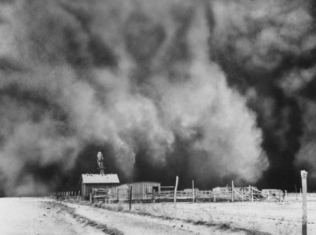 "DUST BOWL / DUST STORM:  Caption reads, ""HERE SHE COMES--This wirephoto, made on a ranch near Boise City in Cimarron county, shows the approach of Sunday's dust storm.  The sun had not set when the blow began and some of the lighter dust clouds reflected its rays, but part of the dust was solid black against the sun.""   Associated Press Wirephoto.  Published 4/16/1935 in The Daily Oklahoman  This photo ran a second time, 6/27/1971 (O-6-27-71E) in The Daily Oklahoman with the following caption: A 'black roller' dust storms swirls down on a ranch yard near Boise City, Okla., in 1935.  In the 'Dust Bowl' year from 1934 through 1938, there were 263 such dust storms recorded in Texas and Oklahoma alone.  Some areas lost as much as a foot of topsoil to the winds.  (AP Photo)  This photo ran a third time in The Daily Oklahoman on 8/29/1976 with the following caption:  Black dusters like this 1938 storm near Boise City brought hard times to Oklahoma farmers during the Depression years.   (Date discrepancy was published as typed here.)"