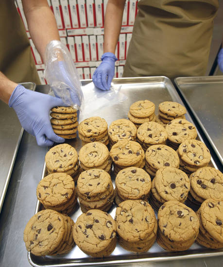 Chocolate chip cookies are packaged at Cookie Advantage in Edmond.
