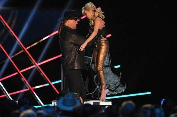 Trace picks up Kristin during a comedy skit on the ACAs.
