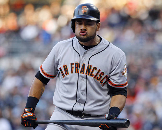 "FILE - In this June 5, 2012, file photo, San Francisco Giants' Melky Cabrera grimaces after striking out during the first inning of a baseball game against the San Diego Padres in San Diego. Major League Baseball says it is ""extremely disappointed"" about a new report that says records from an anti-aging clinic in the Miami area link Alex Rodriguez and other players to the purchase of performance-enhancing drugs. The Miami New Times said in a story Tuesday, Jan. 29, 2013, that it had obtained files through an employee at a recently closed clinic called Biogenesis. Other players named by the publication as appearing in the records include Cabrera, Gio Gonzalez, Bartolo Colon and Nelson Cruz.(AP Photo/Lenny Ignelzi, File)"