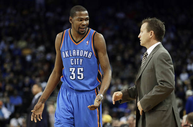 Oklahoma City Thunder's Kevin Durant (35) talks with head coach Scott Brooks during the first half of an NBA basketball game against the Golden State Warriors, Wednesday, Jan. 23, 2013, in Oakland, Calif. (AP Photo/Ben Margot) ORG XMIT: OAS104