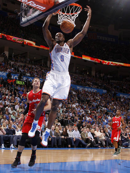 Oklahoma City's Serge Ibaka (9) dunks the ball as Los Angeles' Blake Griffin (32) and Chris Paul (3) watch during the NBA basketball game between the Oklahoma City Thunder and the Los Angeles Clippers at Chesapeake Energy Arena in Oklahoma City, Wednesday, April 11, 2012. Photo by Bryan Terry, The Oklahoman