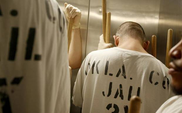 Oklahoma County jail inmate Jesus Lucero rides in an elevator as he cleans along with a group of jail trusties on Tuesday, November 3, 2009. Photo by Bryan Terry ORG XMIT: KOD