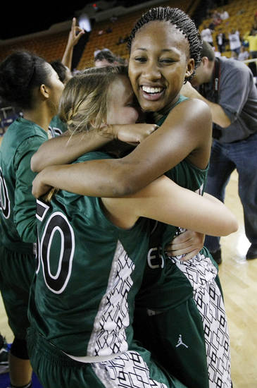 Edmond Santa Fe's Cameerah Graves (10) hugs Taylor Nashert (50) after the Class 6A girls high school basketball state tournament championship game between Edmond Santa Fe and Edmond Memorial at the Mabee Center in Tulsa, Okla., Saturday, March 10, 2012. Santa Fe won, 44-41. Photo by Nate Billings, The Oklahoman