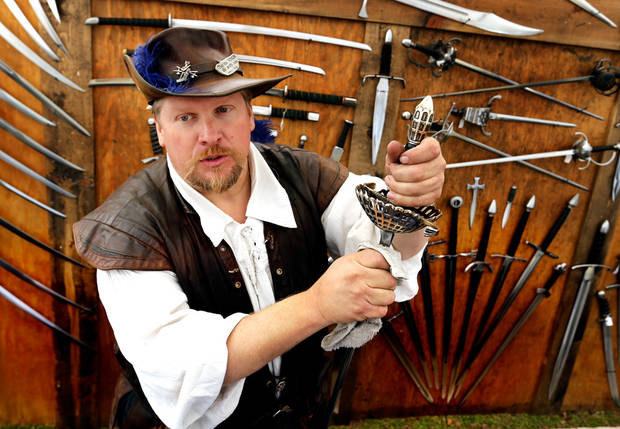 Paul Dubro, Lagacy Forge in Alvarado, Texas, talks about his hand made swords during the Medieval Fair at Reaves Park on Friday, April 5, 2013 in Norman, Okla.  Photo by Steve Sisney, The Oklahoman