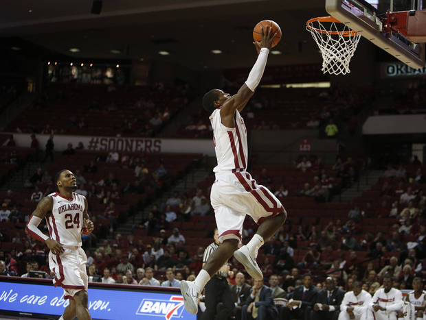 Oklahoma's Buddy Hield (3) dunks during a men's college basketball game between the University of Oklahoma and the University of Louisiana-Monroe at the Loyd Noble Center in Norman, Okla., Sunday, Nov. 11, 2012.  Photo by Garett Fisbeck, The Oklahoman