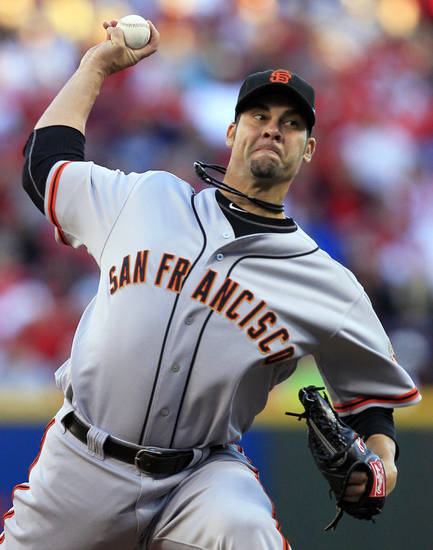 San Francisco Giants starting pitcher Ryan Vogelsong throws against the Cincinnati Reds in the first inning during Game 3 of the National League division baseball series, Tuesday, Oct. 9, 2012, in Cincinnati. (AP Photo/Al Behrman)