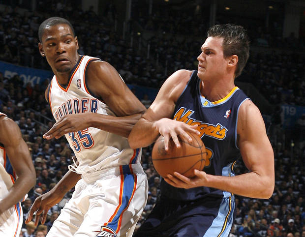 Denver's Danilo Gallinari (8) fights Oklahoma City's Kevin Durant (35) for a loose ball during the NBA basketball game between the Denver Nuggets and the Oklahoma City Thunder in the first round of the NBA playoffs at the Oklahoma City Arena, Wednesday, April 27, 2011. Photo by Sarah Phipps, The Oklahoman