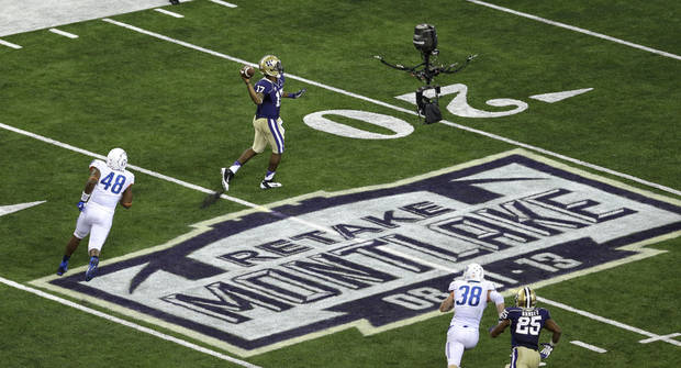 Washington quarterback Keith Price (17) passes for a touchdown against Boise State in the second half of a NCAA college football game, Saturday, Aug. 31, 2013, in Seattle. With the pass, Price became the career leader in touchdown passes thrown at Washington. (AP Photo/Ted S. Warren)