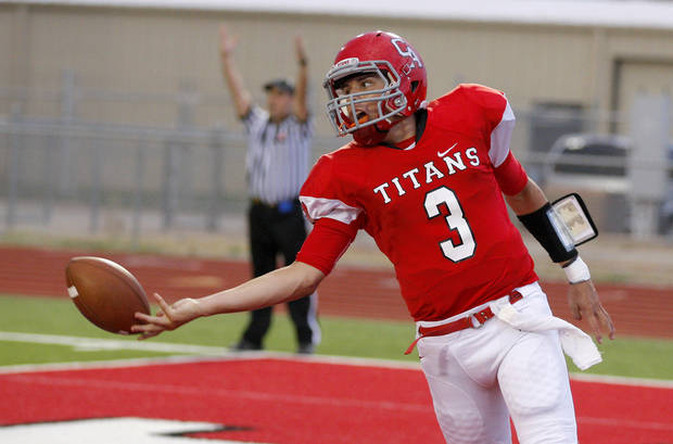 Carl ALbert's Setve Thompson tosses the ball to an official after scoring a touchdown during a high school football game between Carl Albert and Coweta at Carl Albert in Midwest City, Friday, September 7, 2012. Photo by Bryan Terry, The Oklahoman