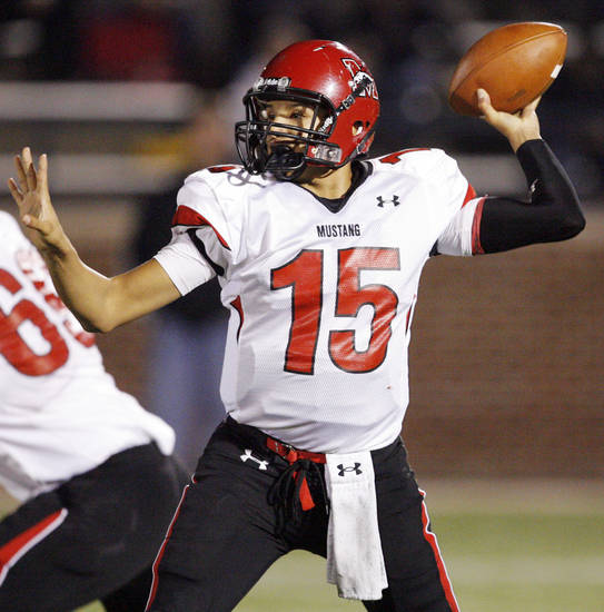 Mustang quarterback Brandon Taylor (15) passes during the Class 6A high school football playoff game between Mustang and Edmond Memorial at Wantland Stadium in Edmond, Okla., Friday, Nov. 13, 2009. Photo by Nate Billings, The Oklahoman
