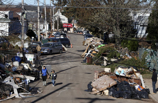 Garbage lies piled on the street in the New Dorp neighborhood of Staten Island, N.Y., Sunday, Nov. 4, 2012, in the aftermath of Superstorm Sandy. (AP Photo/Seth Wenig)