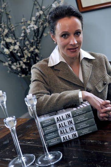 "In this Jan. 15, 2012 photo, Paula Broadwell, author of the David Petraeus biography ""All In,"" poses for photos in Charlotte, N.C. Petraeus, the retired four-star general renowned for taking charge of the military campaigns in Iraq and then Afghanistan, abruptly resigned Friday, Nov. 9, 2012 as director of the CIA, admitting to an extramarital affair. Petraeus carried on the affair with Broadwell, according to several U.S. officials with knowledge of the situation. (AP Photo/The Charlotte Observer, T. Ortega Gaines) LOCAL TV OUT (WSOC, WBTV, WCNC, WCCB); LOCAL PRINT OUT (CHARLOTTE BUSINESS JOURNAL, CREATIVE LOAFLING, CHARLOTTE WEEKLY, MECHLENBURG TIMES, CHARLOTTE MAGAZINE, CHARLOTTE PARENTS) LOCAL RADIO OUT (WBT)"