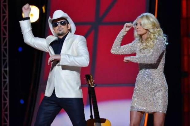 This image released by American Broadcasting Companies, Inc. shows hosts Brad Paisley, left, and Carrie Underwood as they mimic the Gangnam-style dance by South Korean rapper PSY, at the 46th Annual Country Music Awards at the Bridgestone Arena on Thursday, Nov. 1, 2012, in Nashville, Tenn. (AP Photo/ABC)