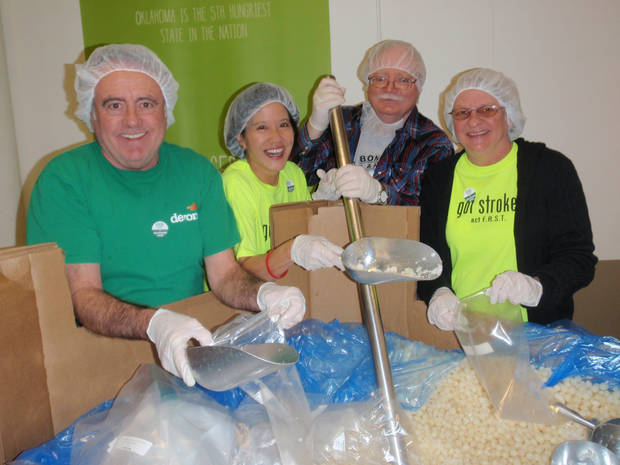 Nelson and Janet Spradlin along with Rod Davidson, a brain injury survivor, and Jean Toolate, whose husband had a stroke, bag pearl onions at the Regional Food Bank of Oklahoma. They volunteer with Operation: Helping Brains, an organization that provides volunteer opportunities for people who are stroke survivors. <strong> - Provided</strong>