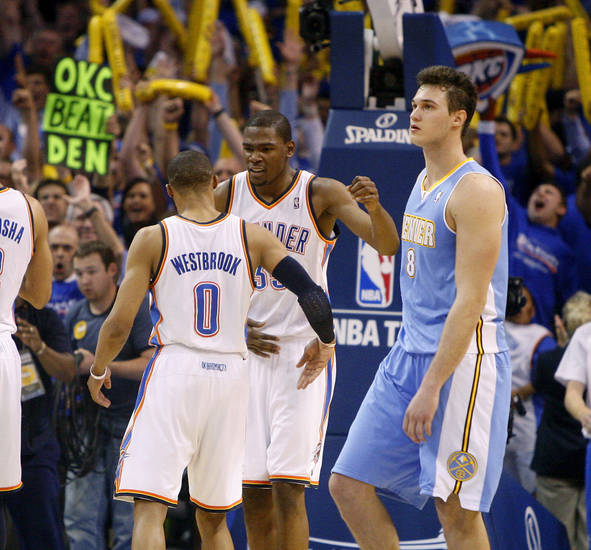 Oklahoma City's Kevin Durant (35) and  Russell Westbrook (0) celebrates as Denver's Danilo Gallinari (8) walks off the court after the NBA basketball game between the Denver Nuggets and the Oklahoma City Thunder in the first round of the NBA playoffs at the Oklahoma City Arena, Sunday, April 17, 2011. Photo by Bryan Terry, The Oklahoman