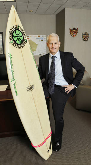Rick Bott, president and chief operating officer of Continental Resources, in his office at Continental Resources in downtown Oklahoma City Friday, Oct. 12, 2012. Rick surfs, the board is by  Hawaiian Island Creations and shaped by CINO. Photo by Paul B. Southerland, The Oklahoman