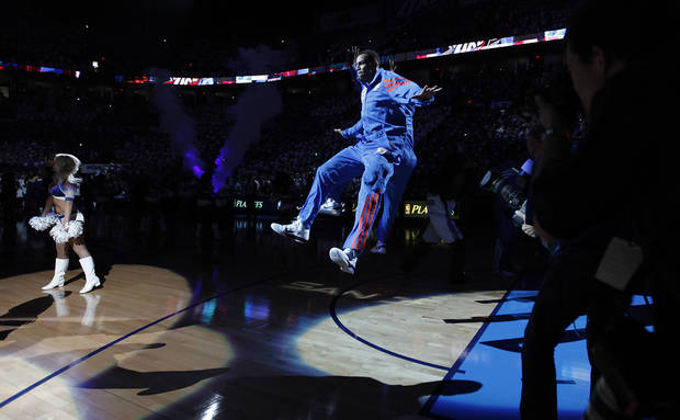 Oklahoma City's Thabo Sefolosha runs onto the court while the team is being introduced during Game 2 in the second round of the NBA playoffs between the Oklahoma City Thunder and the L.A. Lakers at Chesapeake Energy Arena on Wednesday,  May 16, 2012, in Oklahoma City, Oklahoma. Photo by Chris Landsberger, The Oklahoman