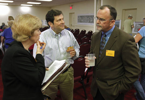 LINDSEY / STREET WIDENING / WIDEN / I-35: Norman Mayor Cindy Rosenthal, councilman Tom Kovach and Shawn O'leary talk before an informational meeting about widening Lindsey between Interstate 35 and Berry Road on Thursday, March 15, 2012, in Norman, Okla.  Photo by Steve Sisney, The Oklahoman