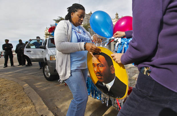 Jenice Brooks work to hang a photo of Martin Luther King Jr. on a float during Martin Luther King Jr. Day parade through downtown Oklahoma City on Monday, Jan. 16, 2012, in Oklahoma City, Okla. Photo by Chris Landsberger, The Oklahoman