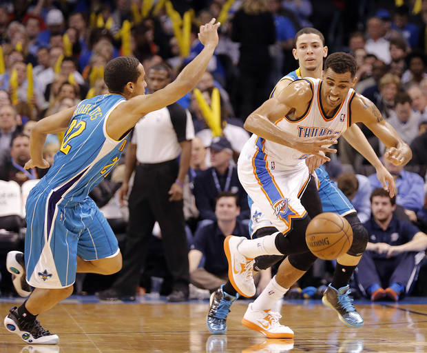 Oklahoma City Thunder's Thabo Sefolosha (2) takes a steal past New Orleans Hornets' Brian Roberts (22) during the NBA basketball game between the Oklahoma City Thunder and the New Orleans Hornets at the Chesapeake Energy Arena on Wednesday, Feb. 27, 2013, in Oklahoma City, Okla. Photo by Chris Landsberger, The Oklahoman