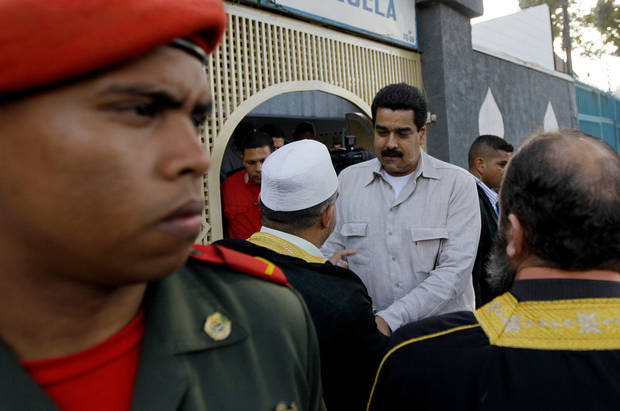 Venezuela's Vice President Nicolas Maduro, center right, talks with members of Venezuela's Islamic community after their meeting in Caracas, Venezuela, Friday, Dec. 14, 2012.  The most influential allies of Venezuela's President Hugo Chavez are projecting an image of unity while he recovers from cancer surgery in Cuba. Maduro was tapped by the 58-year-old president over the weekend as his chosen political heir, considered to be a member of radical left wing of Chavez's movement that is closely aligned with Cuba's communist government. (AP Photo/Fernando Llano)