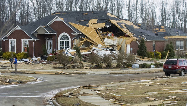A house destroyed by a tornadoin the Eagle Point subdivision, Friday, March 2, 2012 in Limestone County, Ala. (AP Photo/The Decatur Daily, Jeronimo Nisa) ORG XMIT: ALDEC110