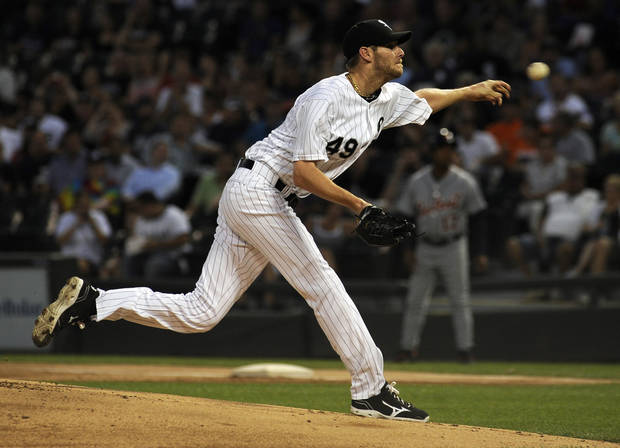Chicago White Sox's Chris Sale (49) pitches in the first inning against the Detroit Tigers during their baseball game in Chicago on Monday, Sept. 9, 2013. (AP Photo/Matt Marton)