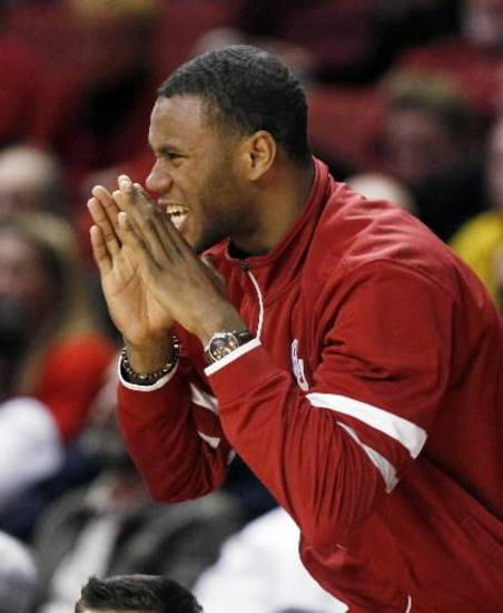 OU's Amath M'Baye yells at his teammates from the bench during a men's college basketball game between the University of Oklahoma Sooners and University of Missouri Tigers at the Lloyd Noble Center in Norman, Okla., Monday, Feb. 6, 2012. Missouri won, 71-68. Photo by Nate Billings, The Oklahoman