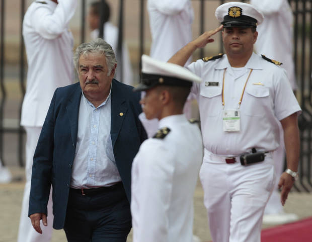 Uruguay's President Jose Mujica arrives for the opening ceremony of the sixth Summit of the Americas at the Convention Center in Cartagena, Colombia, Saturday April 14, 2012. The summit brings together presidents and prime ministers from Canada, the Caribbean, Latin America and the U.S. (AP Photo/Fernando Llano)
