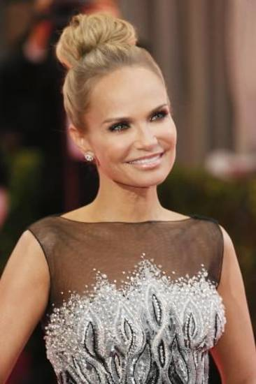 Oklahoma native Kristin Chenoweth smiles on the Oscars red carpet Sunday in Los Angeles. (AP)