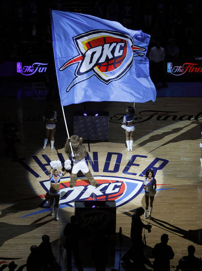 Rumble the Bison waves a flag before Game 1 of the NBA Finals between the Oklahoma City Thunder and the Miami Heat at Chesapeake Energy Arena in Oklahoma City, Tuesday, June 12, 2012. Photo by Bryan Terry, The Oklahoman