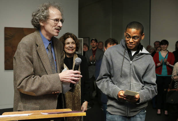 "Ed O'Rear presents the Museum Association Award to Elliott Robbins for his work ""Pantokrator"" during the opening reception of student art show at Fred Jones Jr. Museum of Art at the University of Oklahoma (OU) on Friday, Jan. 18, 2013 in Norman, Okla.  Photo by Steve Sisney, The Oklahoman"