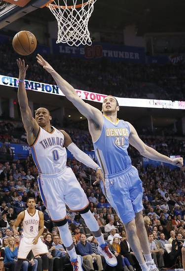 Oklahoma City&#039;s Russell Westbrook (0) shoots past Denver&#039;s Kosta Koufos (41) during the NBA basketball game between the Oklahoma City Thunder and the Denver Nuggets at the Chesapeake Energy Arena on Wednesday, Jan. 16, 2013, in Oklahoma City, Okla.  Photo by Chris Landsberger, The Oklahoman