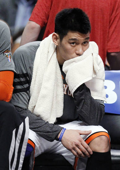 FILE - In this March 12, 2012, file photo, New York Knicks guard Jeremy Lin sits on the bench during the first half of an NBA basketball game against the Chicago Bulls in Chicago. Lin is having left knee surgery and will miss six weeks, likely ending his amazing breakthrough season. The team said Saturday, March 31, 2012, the point guard had an MRI exam this week that revealed a small, chronic meniscus tear. (AP Photo/Charles Rex Arbogast, File)